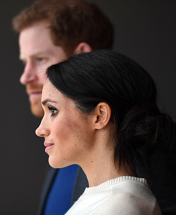 Prince Harry and Duchess Meghan looking serious
