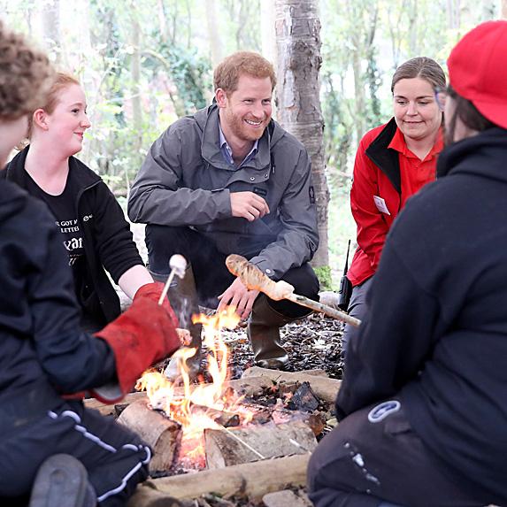 Prince Harry around campfire with teens