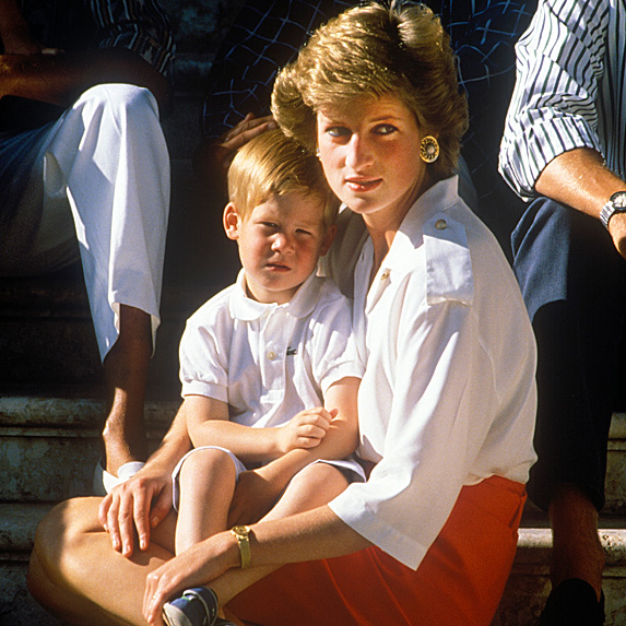 Prince Harry as a toddler sitting on Princess Diana's lap