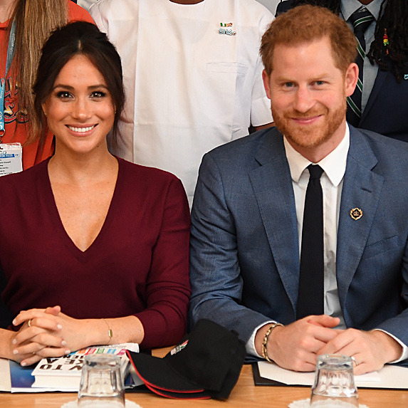 Duchess Meghan and Prince Harry sitting side by side