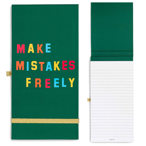 A green notebook by ban.do that says Make Mistakes Freely