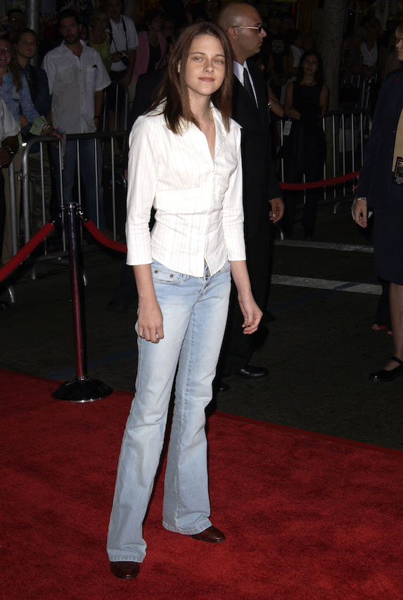 Kristen Stewart wears jeans and a white blouse to a red-carpet film premiere in 2003