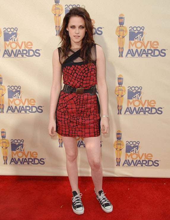 Kristen Stewart wears a funky mini-dress and Converse sneakers on the red carpet at the MTV Movie Awards in 2009