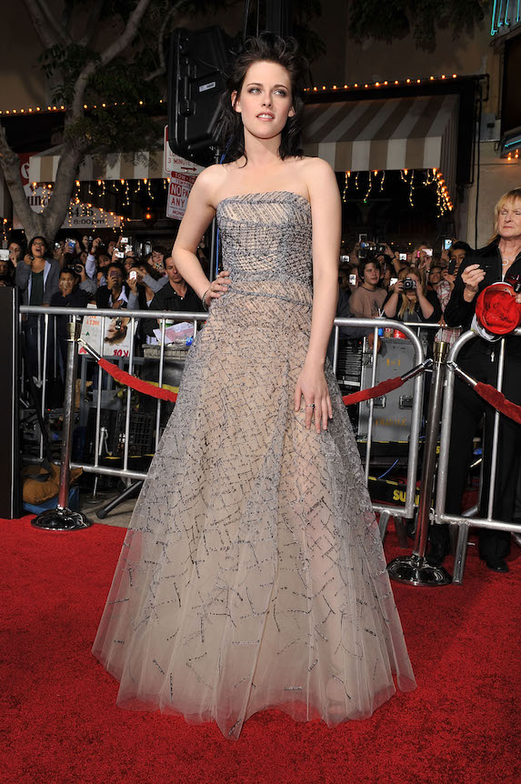 Kristen Stewart wears a floor-length silver ball gown to a film premiere in 2009