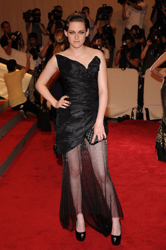Kristen Stewart wears a black gown and heels to a 2010 benefit at the MET Gala