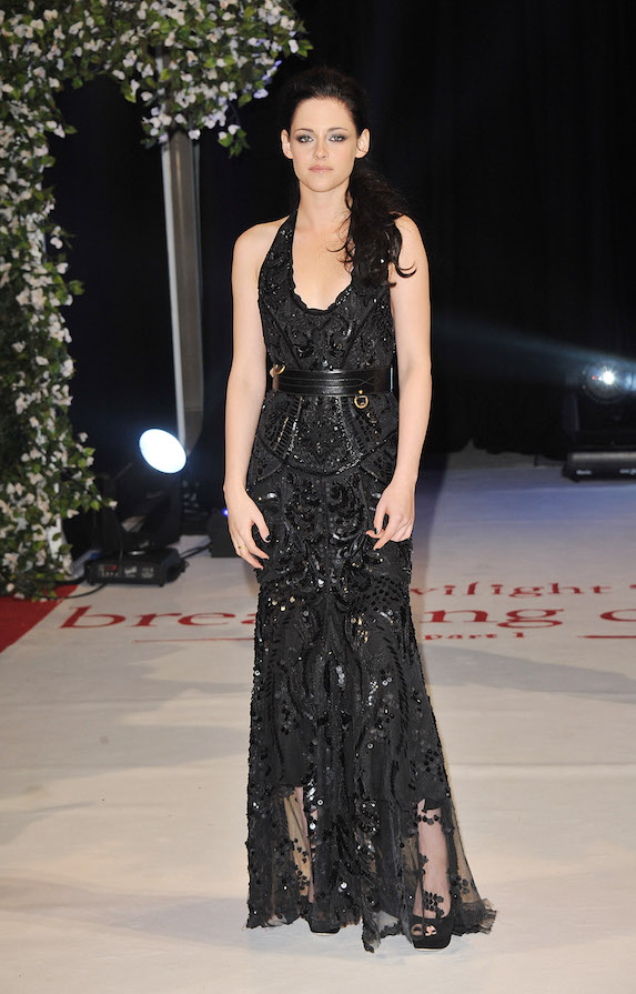 Kristen Stewart wears a floor-length embellished black gown to a 2011 film premiere