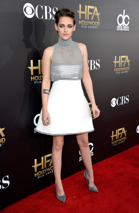 Kristen Stewart wears a white mini dress with gray details to the Hollywood Film Awards in 2014