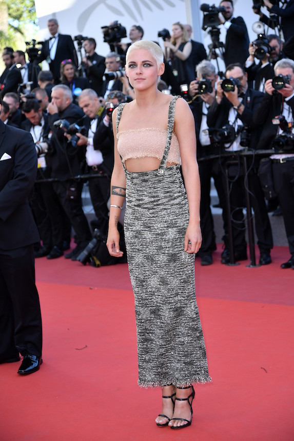 Kristen Stewart wears a suspender dress with a tube top and black strappy heels to the Cannes Film Festival in 2017