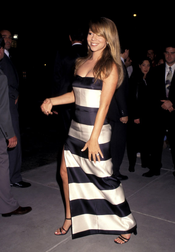 Mariah Carey wears a striped gown to the opening of a designer store in New York City in 1996