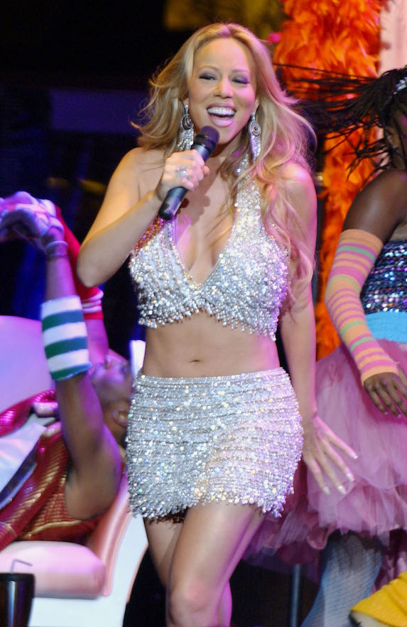 Mariah Carey wears a sequin two-piece outfit while performing in concert in 2003