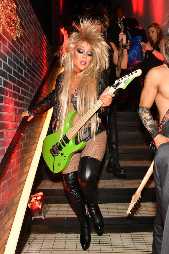 """Mariah Carey is photographed dressed in a """"rock star"""" theme costume for Halloween while attending a party in 2019"""
