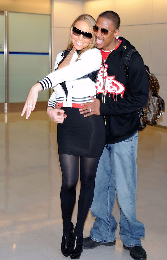 Mariah Carey and Nick Cannon pose together at the airport in Japan in 2008