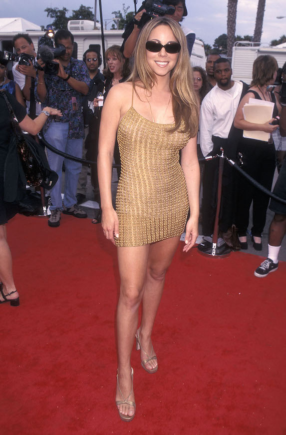 Mariah Carey wears a gold mini-dress at the Soul Train Lady of Soul Awards in 1998