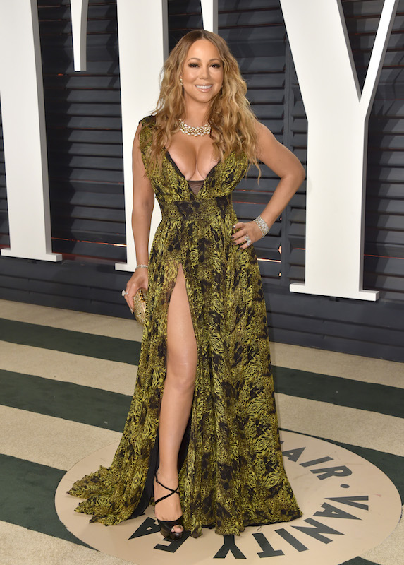 Mariah Carey wears a low-cut printed gown with a high-slit to the Vanity Fair Oscar Party in 2017