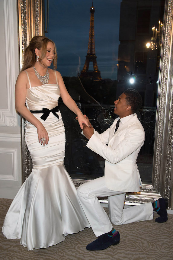 Mariah Carey wears a white satin gown as she poses for photos with then-husband Nick Cannon in 2012