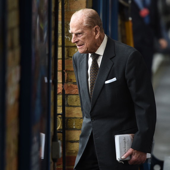 Prince Philip walks out of a meeting