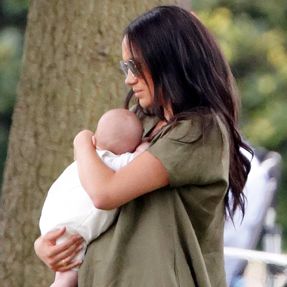 Meghan Markle holding a newborn baby Archie at a family outing