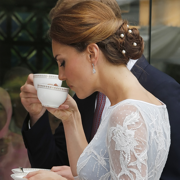 Duchess Kate takes a sip from her teacup during a royal event