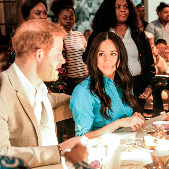 Prince Harry and Meghan Markle sitting