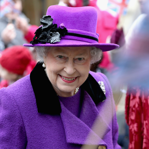 Queen Elizabeth attends a royal event in a bright purple ensemble