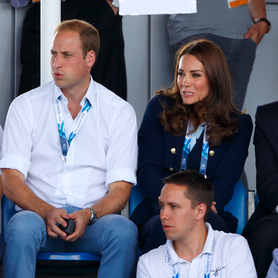 Prince William and Duchess Kate react to a tennis match