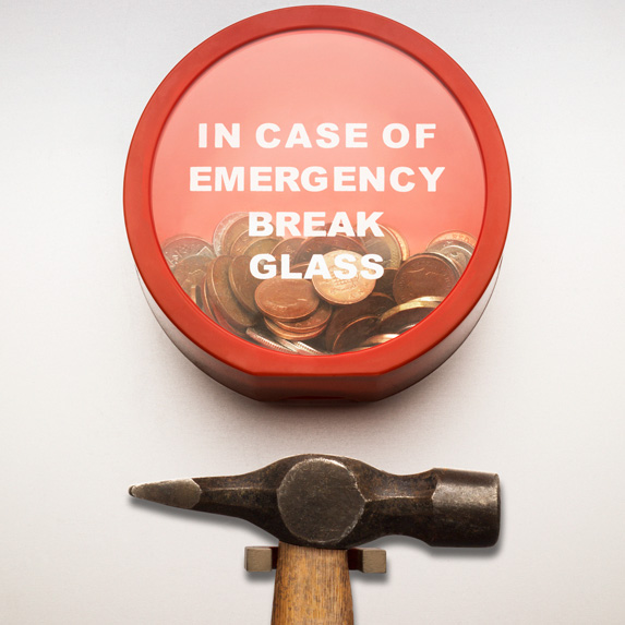 Emergency fund behind glass and a hammer