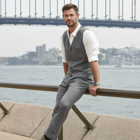 Chris Hemsworth sitting riverside