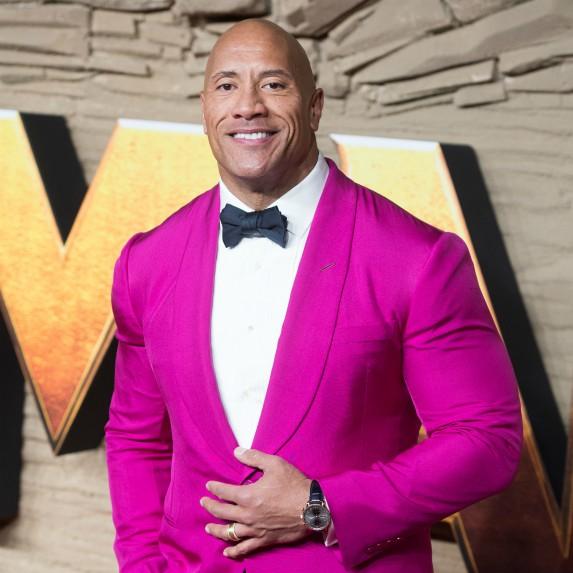 The Rock wearing pink tuxedo