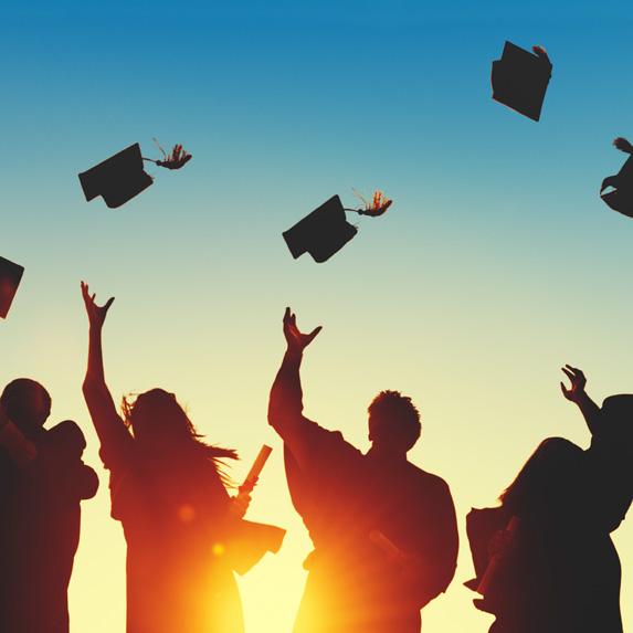 University graduates throwing caps