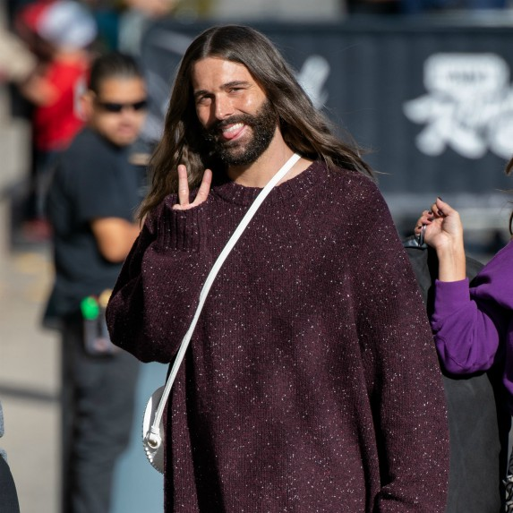 Jonathan Van Ness giving peace sign