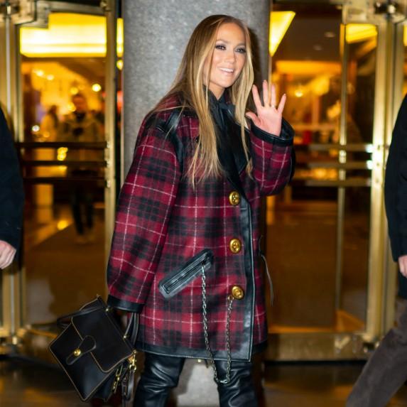 Jennifer Lopez waving at camera