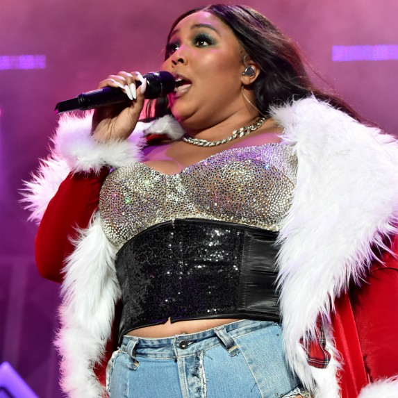 Lizzo singing into microphone