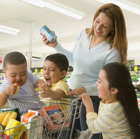 parent with three children at grocery store