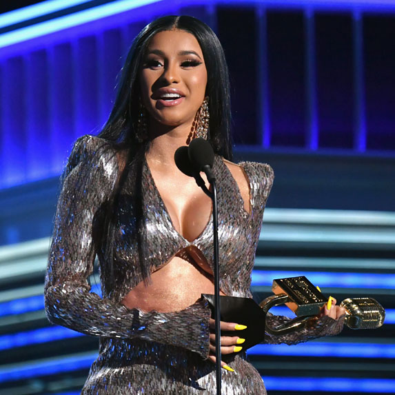 Cardi B accepting an award.