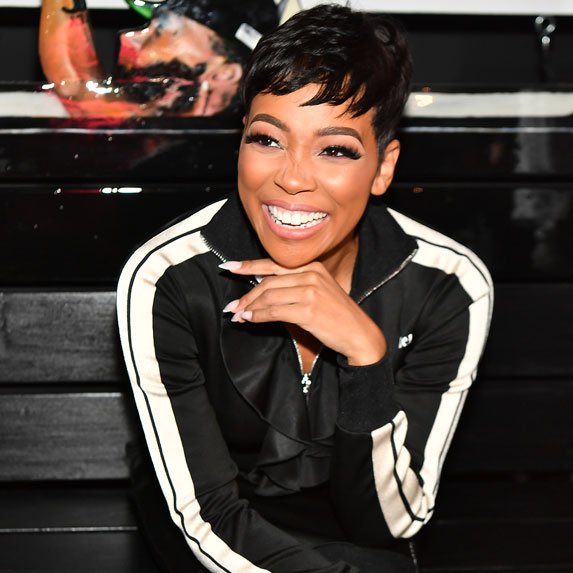 Singer Monica Brown smiling