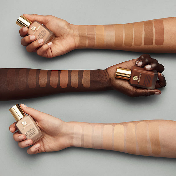 Model arms showcase foundation swatches from Estée Lauder beauty brand