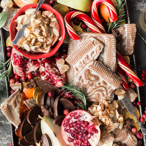 Platter full of cookies, candies and other food