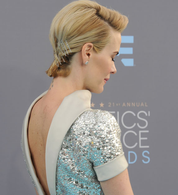 Sarah Paulson wears her short hair slicked back with exposed pins