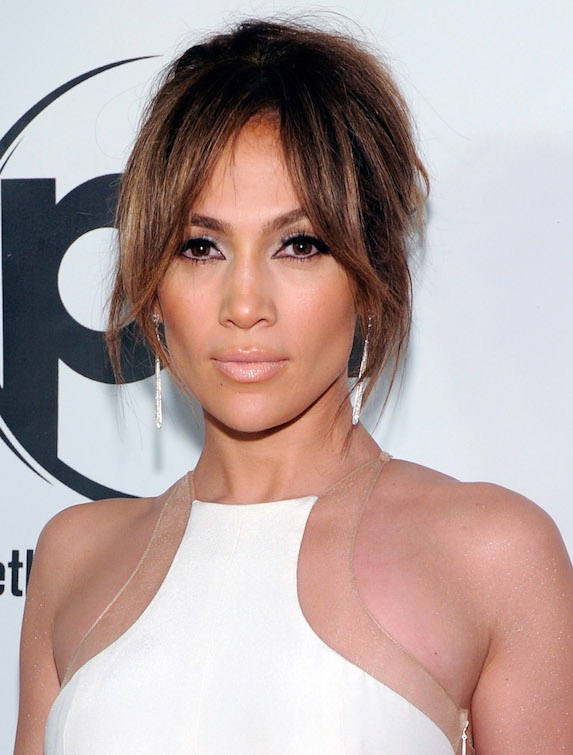 Jennifer Lopez wears her hair up with fringe bangs