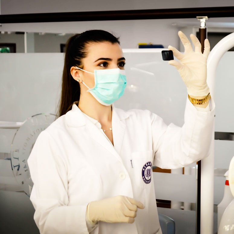Canadian nurse in medical mask