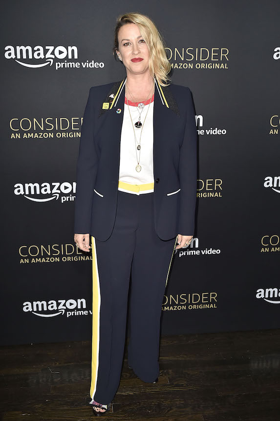 Alanis Morissette dons shorter blonde hair and an ill-fitting navy pantsuit to an event for Amazon Prime in 2017