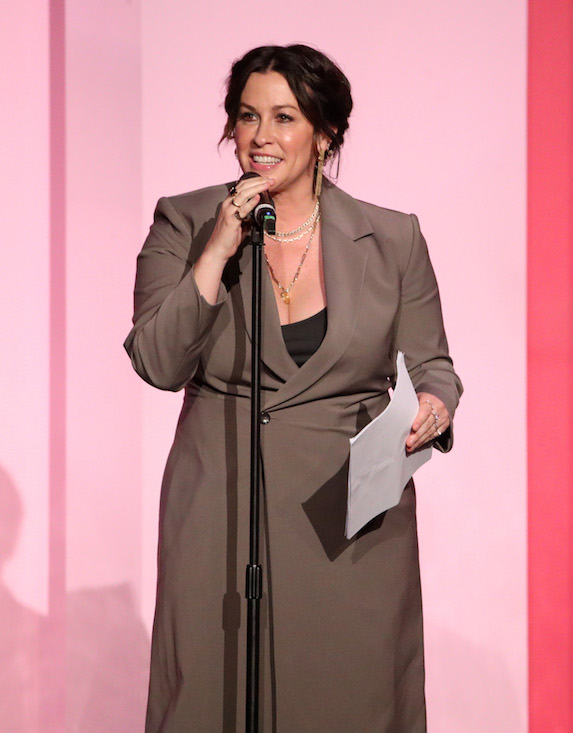 Alanis Morissette wears a double-breasted blazer dress on stage at Billboard's Women in Music in 2019