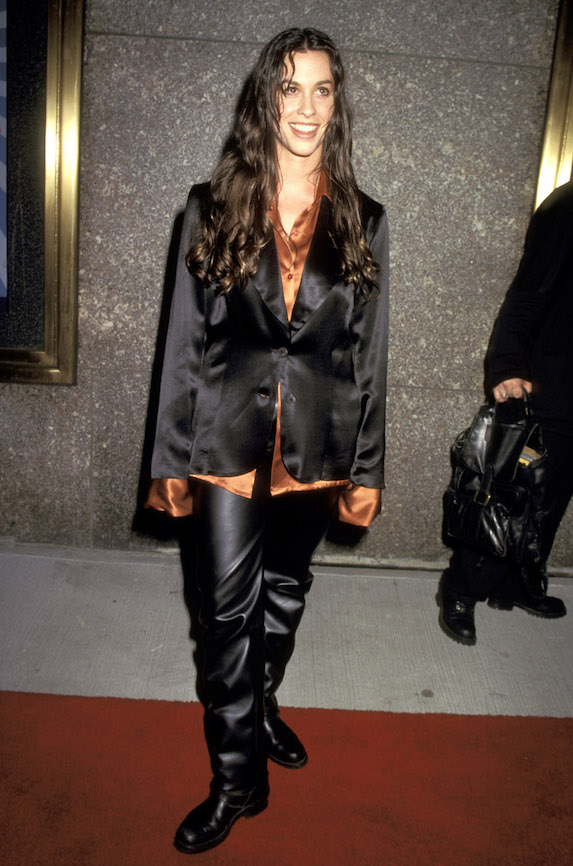 Alanis Morissette wears leather pants, a satin oversized blouse and black blazer to the MTV Video Music Awards in 1995
