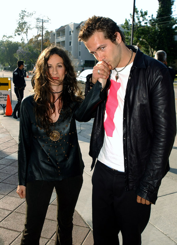 Alanis Morissette and then-boyfriend, actor Ryan Reynolds attend the MTV Movie Awards in 2003
