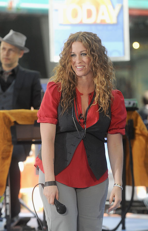Alanis Morissette wears a red shirt, vest and grey pants while performing on NBC's Today show in 2008