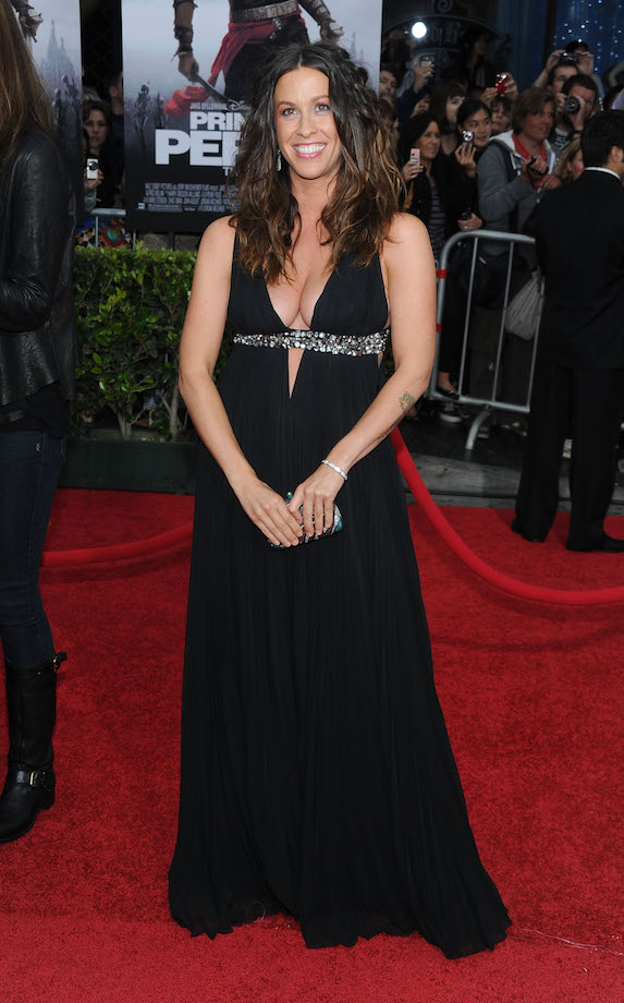 Alanis Morissette wears a black floor-length gown with bejeweled detail and low-cut neckline to a 2010 film premiere