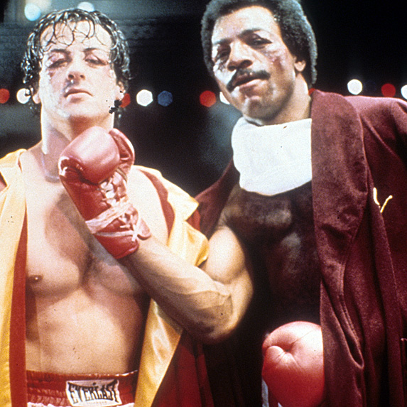 Sylvester Stallone and Carl Weathers as Rocky and Apollo from Rocky