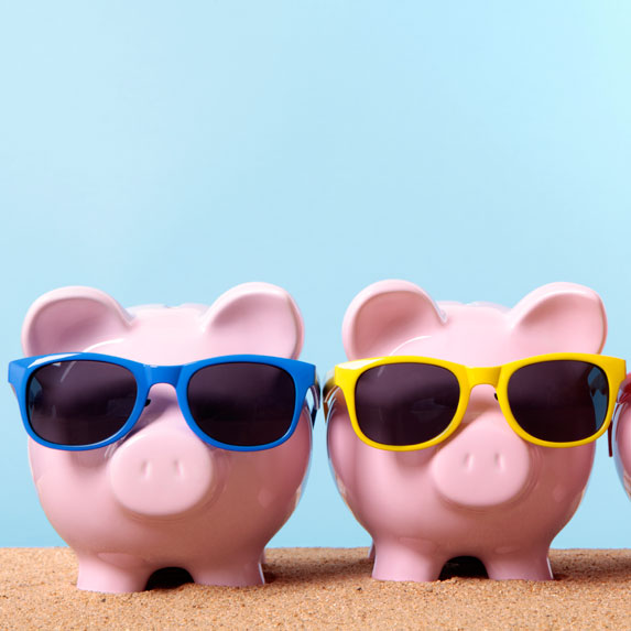 two piggy banks wearing sun glasses
