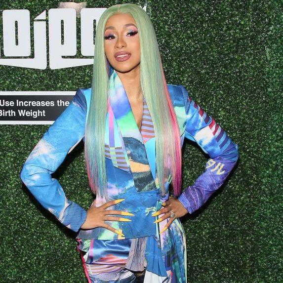 Cardi B wears a multi-colour wrap dress