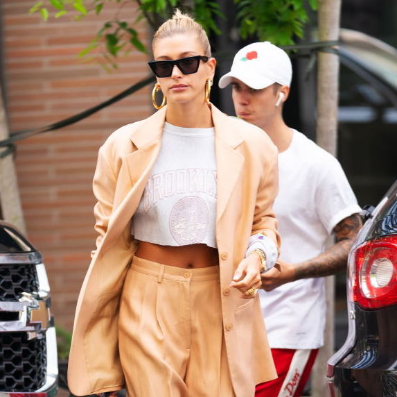 Hailey Bieber wearing a camel-coloured suit with a cropped t-shirt